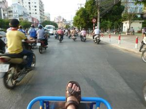 Exploring the busy streets of Saigon in a rickshaw.