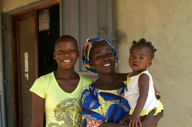 Assana (middle) today with her 2 daughters.